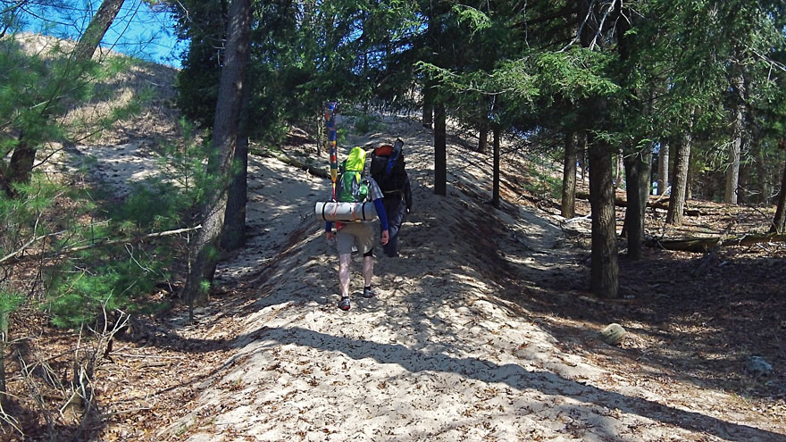 4-climbing-dune-with-backpacks-ludington