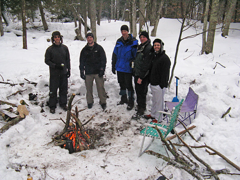 27-group-back-at-winter-camp-fire