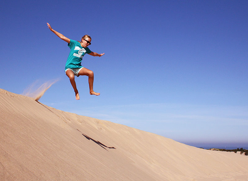 13-jumping-down-sand-dunes-silver-lake-state-park